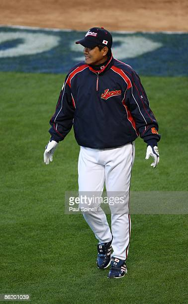 Manager Tatsunori Hara of Japan heads back to the dugout after a visit to the pitcher's mound as his team plays USA in game two of the semifinal...