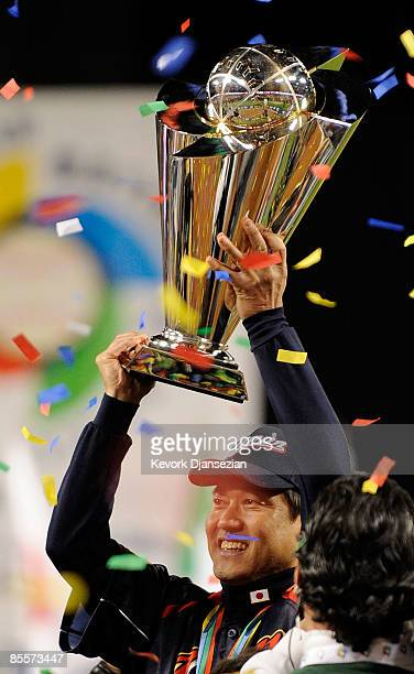 Manager Tatsunori Hara of Japan holds up the championship trophy after defeating Korea during the finals of the 2009 World Baseball Classic on March...