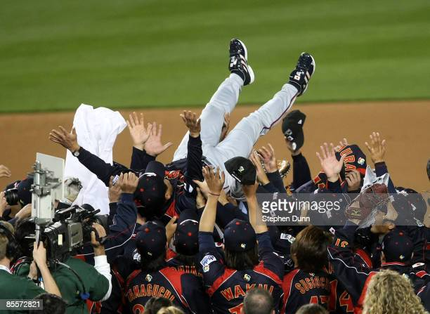 Manager Tatsunori Hara of Japan is tossed in the air by his players after defeating Korea during the finals of the 2009 World Baseball Classic on...