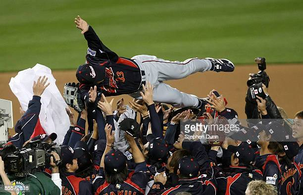 Manager Tatsunori Hara of Japanis tossed in the air by his players after defeating Korea during the finals of the 2009 World Baseball Classic on...