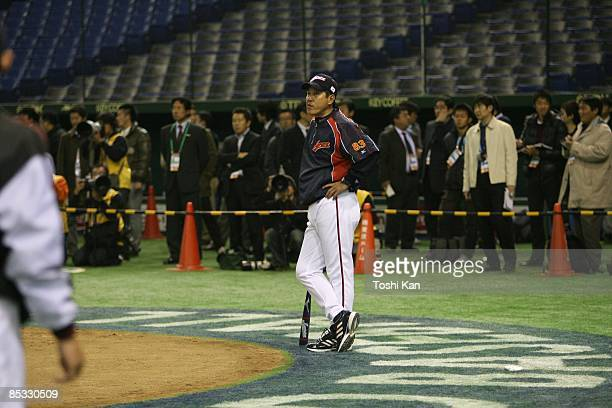 Manager Tatsunori Hara of Team Japan watches players during batting practice at a workout day before the 2009 World Baseball Classic on Wednesday...