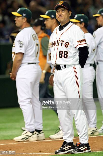 Manager Tatsunori Hara of Yomiuri Giants looks on during preseason friendly game between Oakland Athletics and Yomiuri Giants at Tokyo Dome on March...