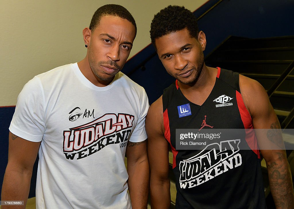 Manager Team Ludacris and Manager Team Usher get there game face on during Neuro Drinks At LudaDay Weekend Celebrity Basketball Game at GSU Sports Arena on September 1, 2013 in Atlanta, Georgia.