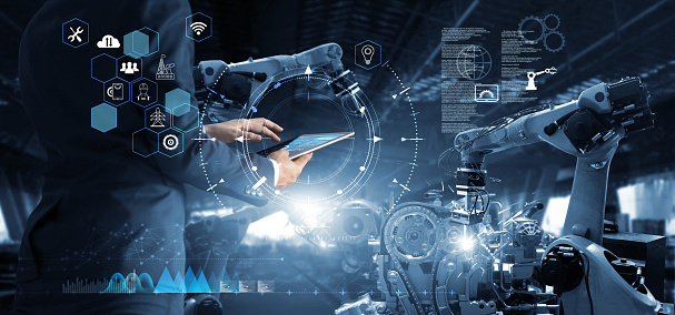 Manager Technical Industrial Engineer working and control robotics with monitoring system software and icon industry network connection on tablet. AI, Artificial Intelligence, Automation robot arm 1150197773