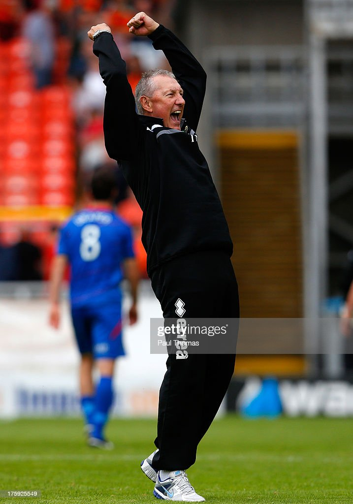 Manager Terry Butcher of Inverness Caledonian Thistle celebrates at full time of the Scottish Premier League match between Dundee United and Inverness Caledonian Thistle at Tannadice Park on August 10, 2013 in Dundee, Scotland