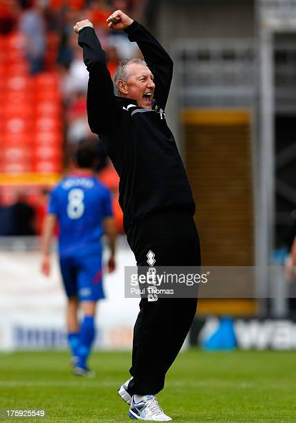 Manager Terry Butcher of Inverness Caledonian Thistle celebrates at full time of the Scottish Premier League match between Dundee United and...