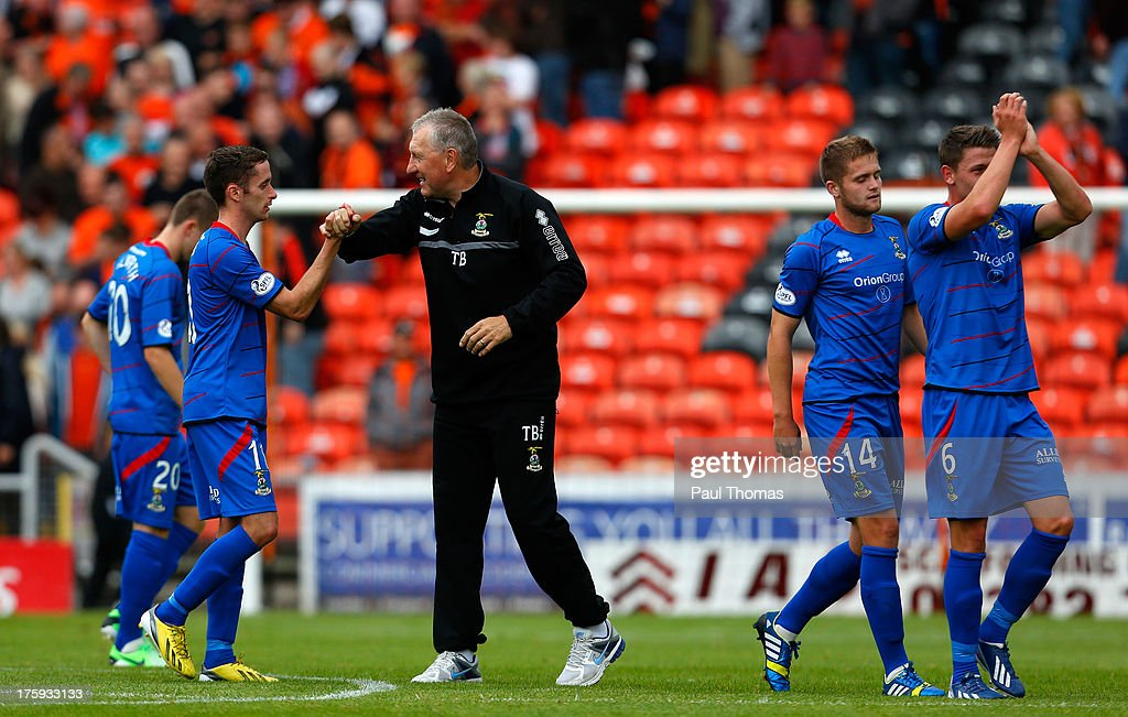 Manager Terry Butcher of Inverness Caledonian Thistle celebrates with Nick Ross at full time of the Scottish Premier League match between Dundee United and Inverness Caledonian Thistle at Tannadice Park on August 10, 2013 in Dundee, Scotland