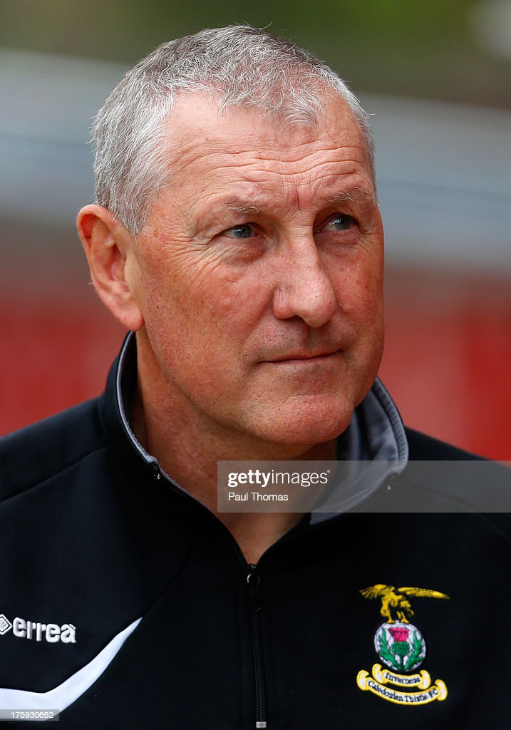Manager Terry Butcher of Inverness Caledonian Thistle looks on during the Scottish Premier League match between Dundee United and Inverness Caledonian Thistle at Tannadice Park on August 10, 2013 in Dundee, Scotland