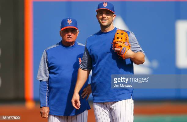 Manager Terry Collins and David Wright of the New York Mets look on before a game against the Atlanta Braves during Opening Day at Citi Field on...