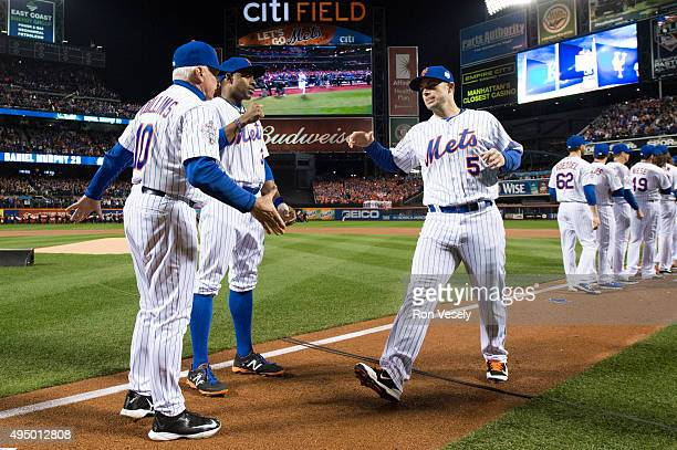 Manager Terry Collins and David Wright of the New York Mets shake hands during player introductions Game 3 of the 2015 World Series against the...