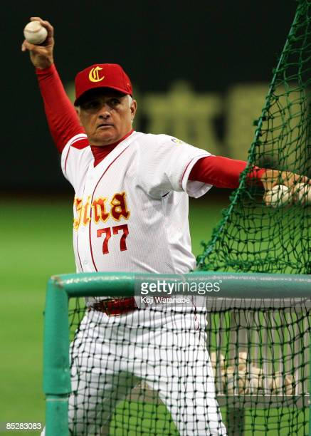 Manager Terry Collins of Team China throws to players warming-up prior to Game 3 of the 2009 World Baseball Classic Pool A match between China and...