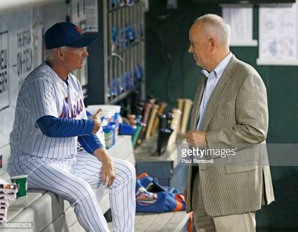 Manager Terry Collins of the New York Mets and General Manager Sandy Alderson have a talk in the dugout before the Mets played their last home game...
