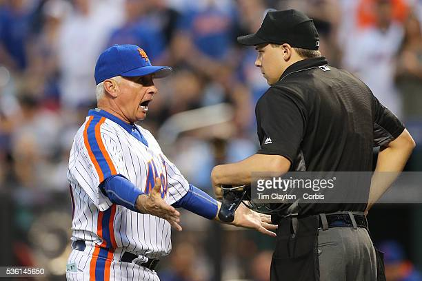Manager Terry Collins of the New York Mets argues with umpire Adam Hamari who tossed Noah Syndergaard of the New York Mets out of the game for...