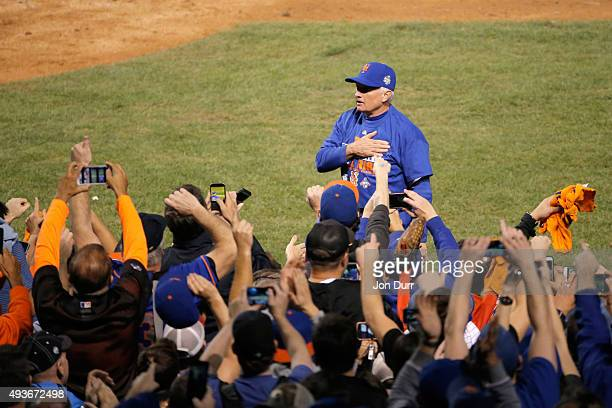Manager Terry Collins of the New York Mets celebrates on field after defeating the Chicago Cubs in game four of the 2015 MLB National League...