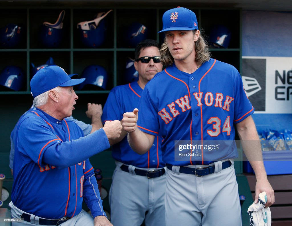 Manager Terry Collins #10 of the New York Mets fist bumps pitcher Noah Syndergaard #34 before the start of a game against the Philadelphia Phillies at Citizens Bank Park on October 1, 2017 in Philadelphia, Pennsylvania. Collins is likely managing in his last game for the Mets.