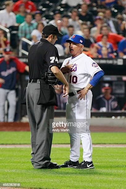 Manager Terry Collins of the New York Mets has a discussion with home plate umpire John Tumpane after pitcher Bartolo Colon was ejected in the fourth...