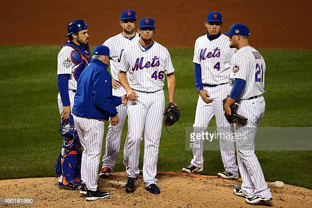 Manager Terry Collins of the New York Mets pulls pitcher Tyler Clippard out of the game in the eighth inning against the Kansas City Royals during...