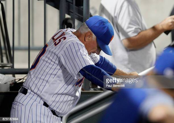 Manager Terry Collins of the New York Mets reacts in the dugout in the ninth inning of an MLB baseball game with his team losing to the Los Angeles...