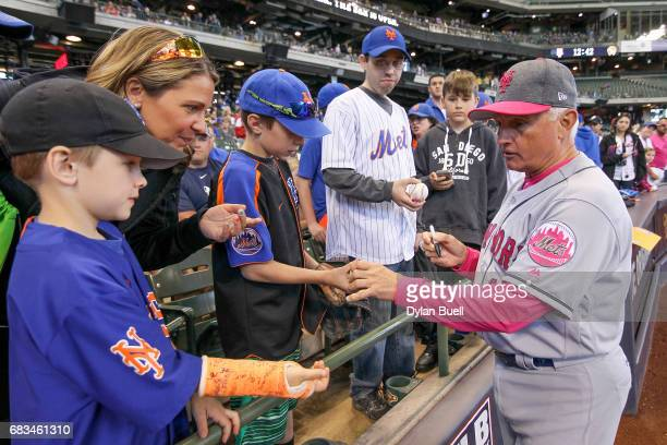Manager Terry Collins of the New York Mets signs autographs for fans before the game against the Milwaukee Brewers at Miller Park on May 14 2017 in...