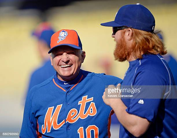 Manager Terry Collins of the New York Mets smiles as he talk with Justin Turner of the Los Angeles Dodgers during batting practice at Dodger Stadium...
