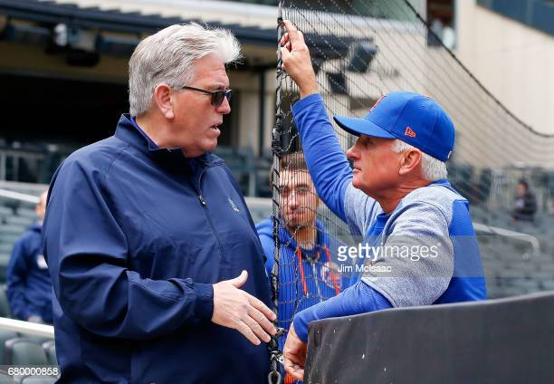 Manager Terry Collins of the New York Mets talks with sports radio personality Mike Francesa before the start of a game against the Miami Marlins at...