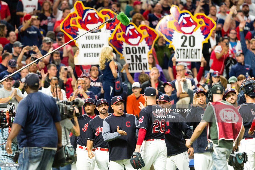 Manager Terry Francona #17 celebrates with starting pitcher Corey Kluber #28 of the Cleveland Indians after the Indians defeated the Detroit Tigers at Progressive Field on September 12, 2017 in Cleveland, Ohio. The Indians defeated the Tigers for their 20th straight win.