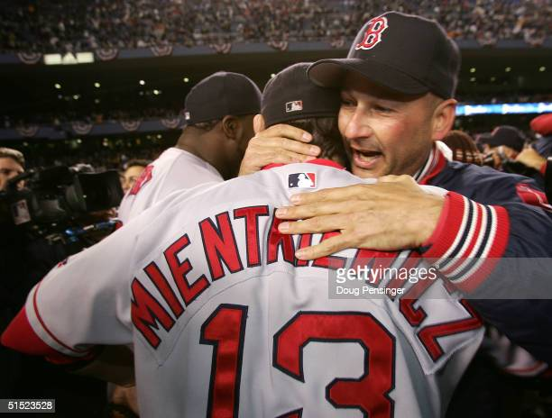 Manager Terry Francona of the Boston Red Sox celebrates with Doug Mientkiewicz after defeating the New York Yankees 10-3 to win game seven of the...