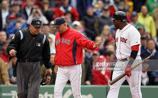 Manager Terry Francona of the Boston Red Sox restrains David Ortiz and argues a third strike call with Home Plate umpire Dale Scott during the game...
