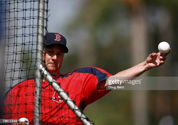 Manager Terry Francona of the Boston Red Sox throws batting practice before taking on the Los Angeles Dodgers during a spring training game on March...