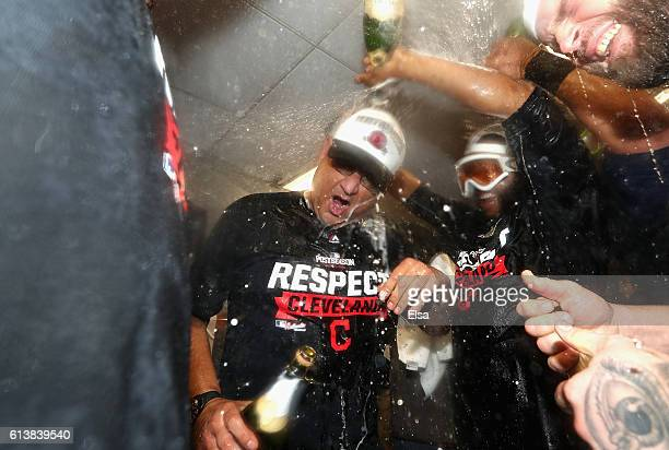 Manager Terry Francona of the Cleveland Indians celebrates with players in the clubhouse after defeating the Boston Red Sox 43 in game three of the...