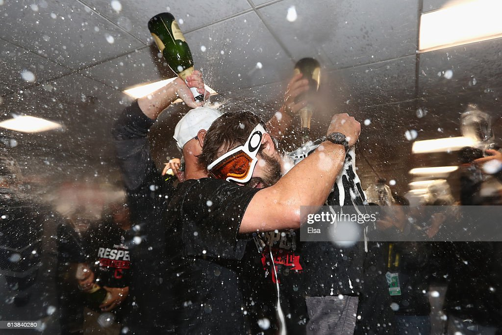 Manager Terry Francona of the Cleveland Indians (L) celebrates with Andrew Miller #24 in the clubhouse after defeating the Boston Red Sox 4-3 in game three of the American League Divison Series to advance to the American League Championship Series at Fenway Park on October 10, 2016 in Boston, Massachusetts.