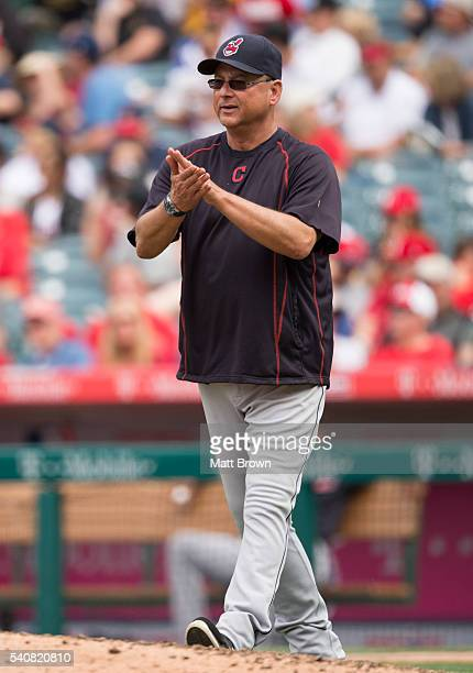 Manager Terry Francona of the Cleveland Indians claps as he visits the mound to make a pitching change during the seventh inning of the game against...