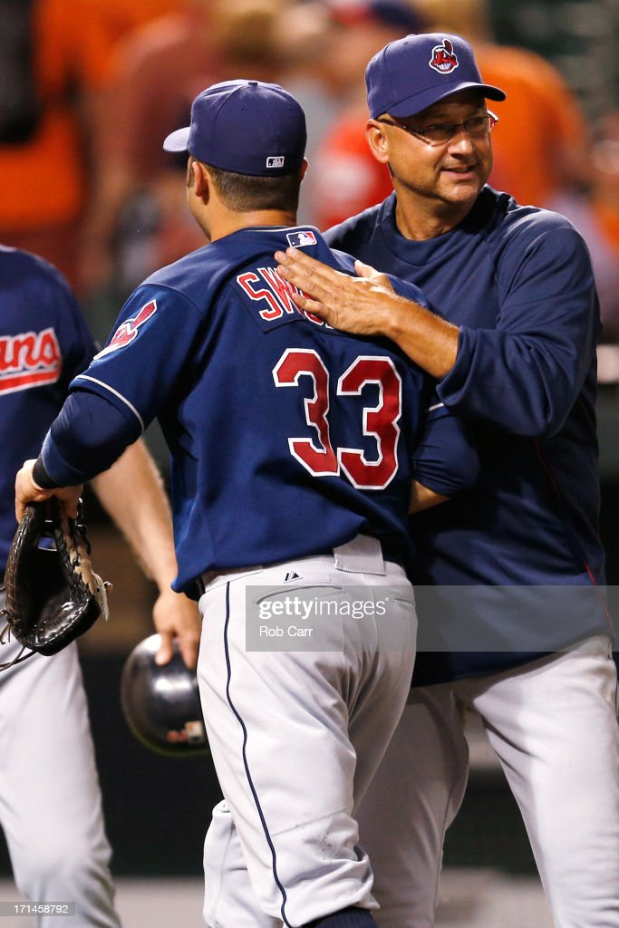 Manager Terry Francona #17 of the Cleveland Indians congratulates Nick Swisher #33 after the Indians defeated the Baltimore Orioles 5-2 at Oriole Park at Camden Yards on June 24, 2013 in Baltimore, Maryland.