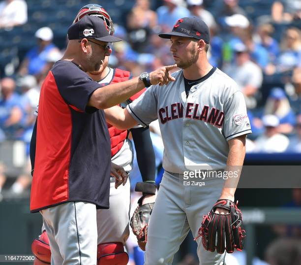 Manager Terry Francona of the Cleveland Indians gestures as starting pitcher Trevor Bauer leaves a game in the fifth inning against the Kansas City...