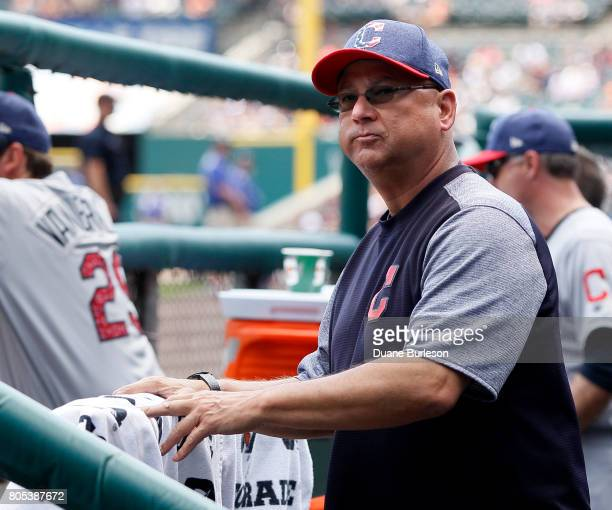 Manager Terry Francona of the Cleveland Indians looks around the dugout during the third inning of game one of a doubleheader against the Detroit...