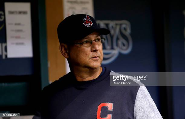 Manager Terry Francona of the Cleveland Indians looks on from the dugout during the eighth inning of a game against the Tampa Bay Rays on August 10...