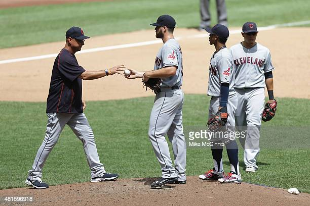Manager Terry Francona of the Cleveland Indians takes Cody Anderson out of the game in the third inning against the Milwaukee Brewers during the...