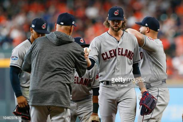 Manager Terry Francona of the Cleveland Indians takes out Adam Cimber in the seventh inning against the Houston Astros during Game One of the...