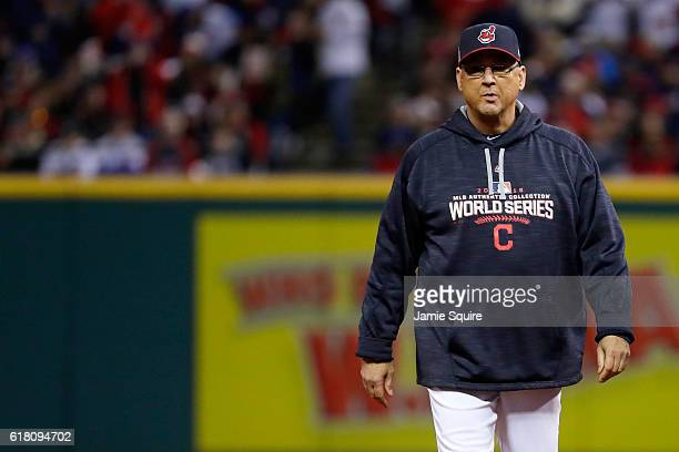 Manager Terry Francona of the Cleveland Indians walks on the field after Carlos Santana suffered an apparent injury during the third inning in Game...