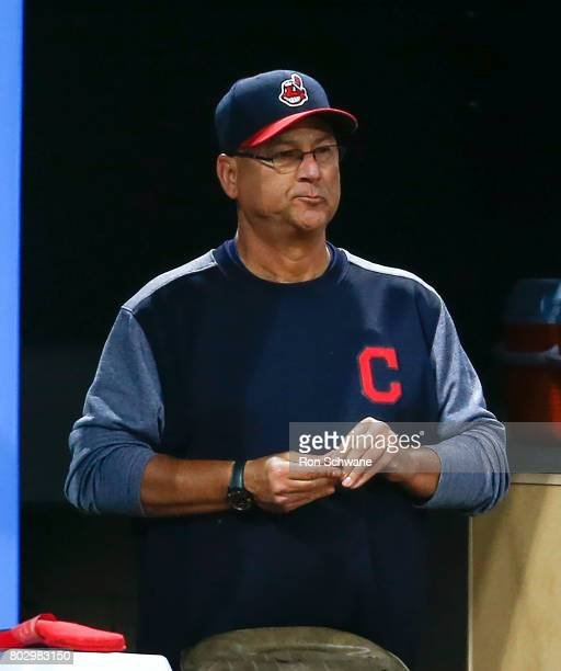 Manager Terry Francona of the Cleveland Indians watches from the dugout during the seventh inning against the Texas Rangers at Progressive Field on...