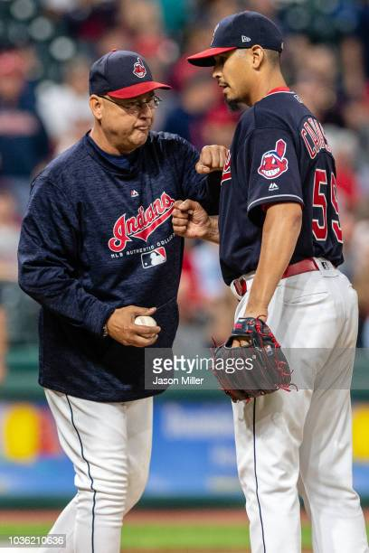 Manager Terry Francona removes starting pitcher Carlos Carrasco of the Cleveland Indians from the game during the seventh inning against the Chicago...