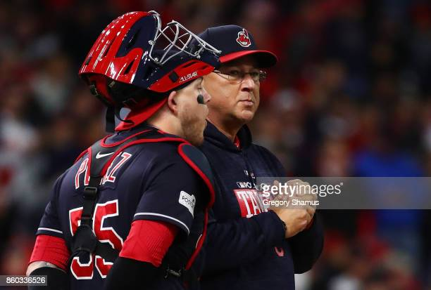 Manager Terry Francona stands with Roberto Perez of the Cleveland Indians on the mound in the fourth inning against the New York Yankees in Game Five...