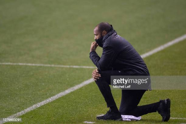 Manager Thierry Henry of the Montreal Impact takes a knee during the national anthem prior to the match against the Philadelphia Union at Subaru Park...