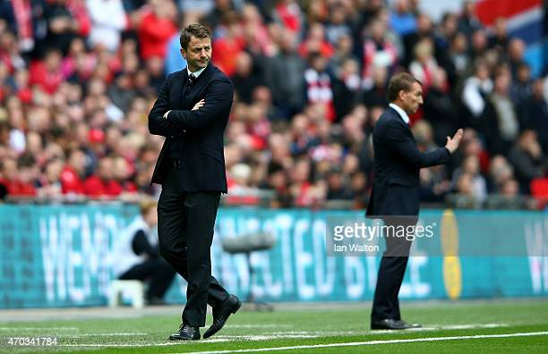 Manager Tim Sherwood of Aston Villa and Brendan Rodgers manager of Liverpool on the touchline during the FA Cup Semi Final between Aston Villa and...