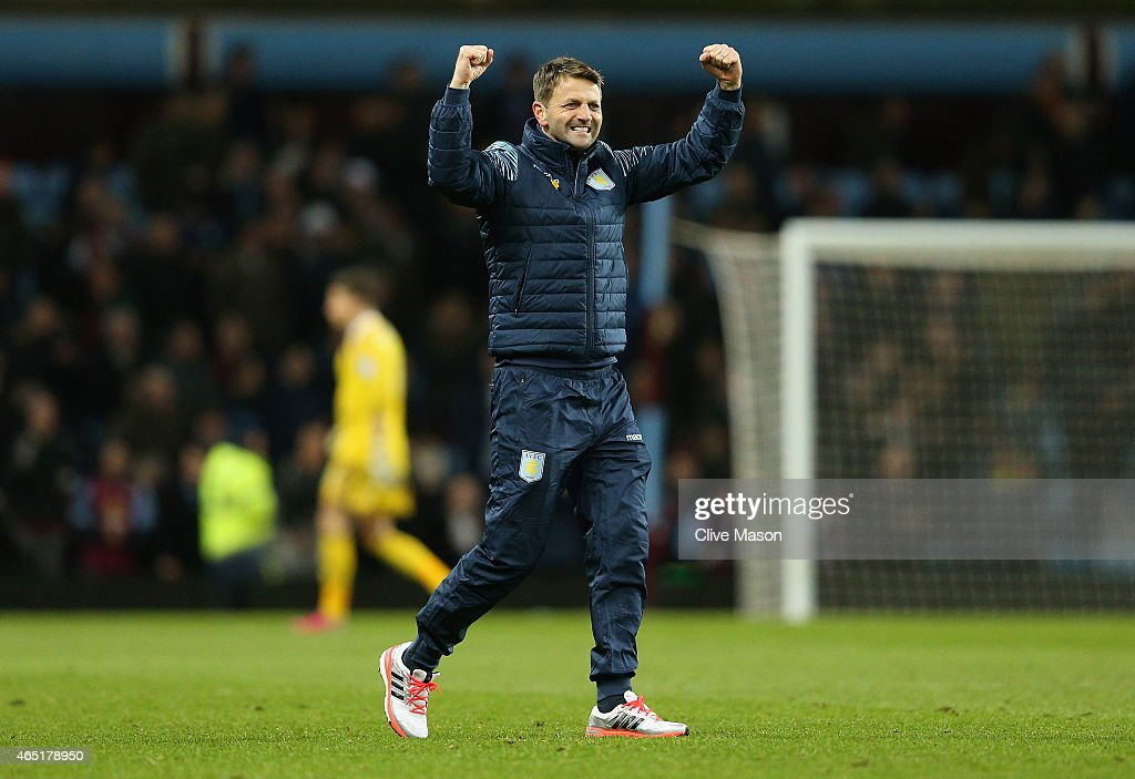 Manager Tim Sherwood of Aston Villa celebrates the 2-1 victory on the pitch after the Barclays Premier League match between Aston Villa and West Bromwich Albion at Villa Park on March 3, 2015 in Birmingham, England.