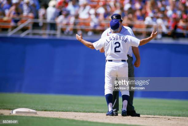 Manager Tommy Lasorda of the Los Angeles Dodgers argues with an umpire during a game in the 1987 season at Dodger Stadium in Los Angeles California