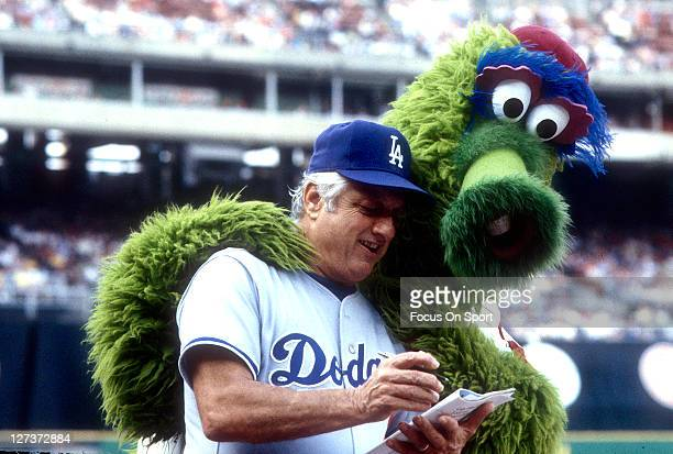 Manager Tommy Lasorda of the Los Angeles Dodgers with the Phillie Fanatic during an MLB baseball game at Veterans Stadium circa 1981 in Philadelphia,...