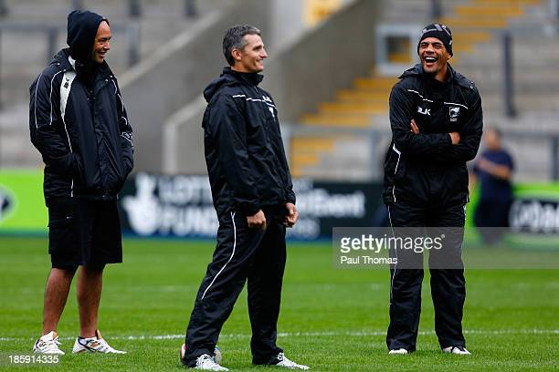 Manager Tony Iro, assistant coach Ivan Cleary and head coach Stephen Kearney, all of New Zealand, share a joke during the New Zealand training...