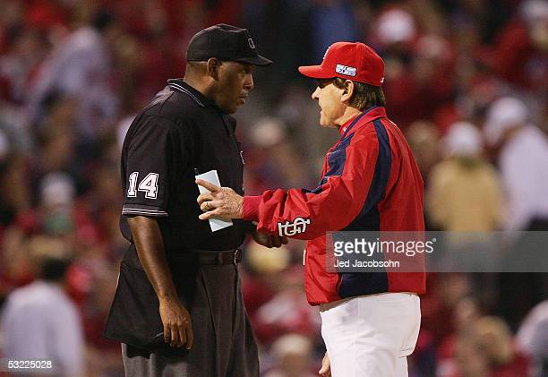 Manager Tony La Russa of the St Louis Cardinals has a discussion with home plate umpire Chuck Meriwether in game four of the World Series against the...