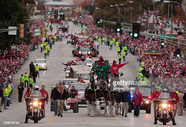 Manager Tony La Russa of the St Louis Cardinals rides with the Budweiser Clydesdales during a parade celebrating the team's 11th World Series...